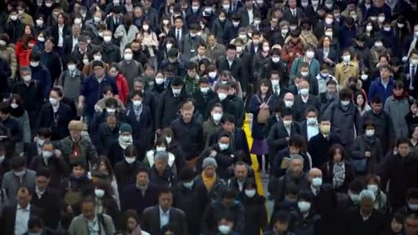 Tokyo, Japan-04 February, 2020: 4K, Aerial large crowd people wearing surgical mask walking in subway exit. Coronavirus pneumonia has been spreading into many cities. 2019-nCoV epidemic of China.-Dan