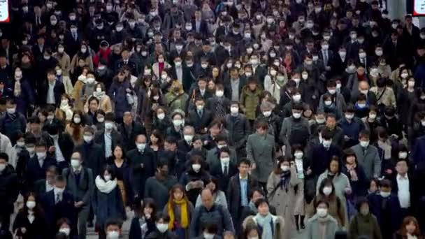 Tokyo, Japan-04 February, 2020: 4K, Concept of coronavirus quarantine, MERS-Cov. Large crowd of business people with medical face mask. Air pollution. The virus has caused emergency situation.-Dan