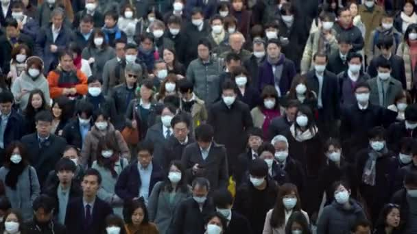 Tokyo, Japan-04 February, 2020: Large crowd people wearing surgical mask walking in subway exit. Coronavirus pneumonia has been spreading into many cities. 2019-nCoV epidemic of China.-Dan