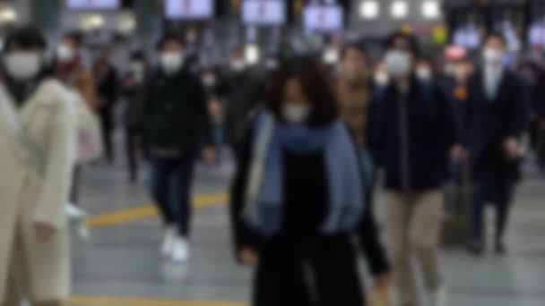 Slow motion Blurred defocused view of large crowd people wearing surgical mask walking in subway exit. Coronavirus pneumonia spreading into cities. 2019-nCoV epidemic of China-Dan