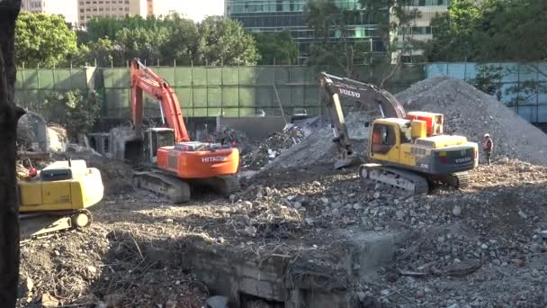 Taipei, Taiwan-02 March, 2016: 4k Excavators, backhoe and Lift Magnet working on a construction site in a sun day, demolishing the old ruined house and building a new house in Taiwan-Dan