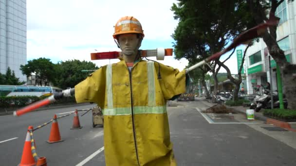 Taipei, Taiwan-12 September, 2017: 4K Taiwan road safety dummies. Warning dummie with electric flag-bearers in traffic street Taipei. Robotic figures in roadside construction, protection workers-Dan