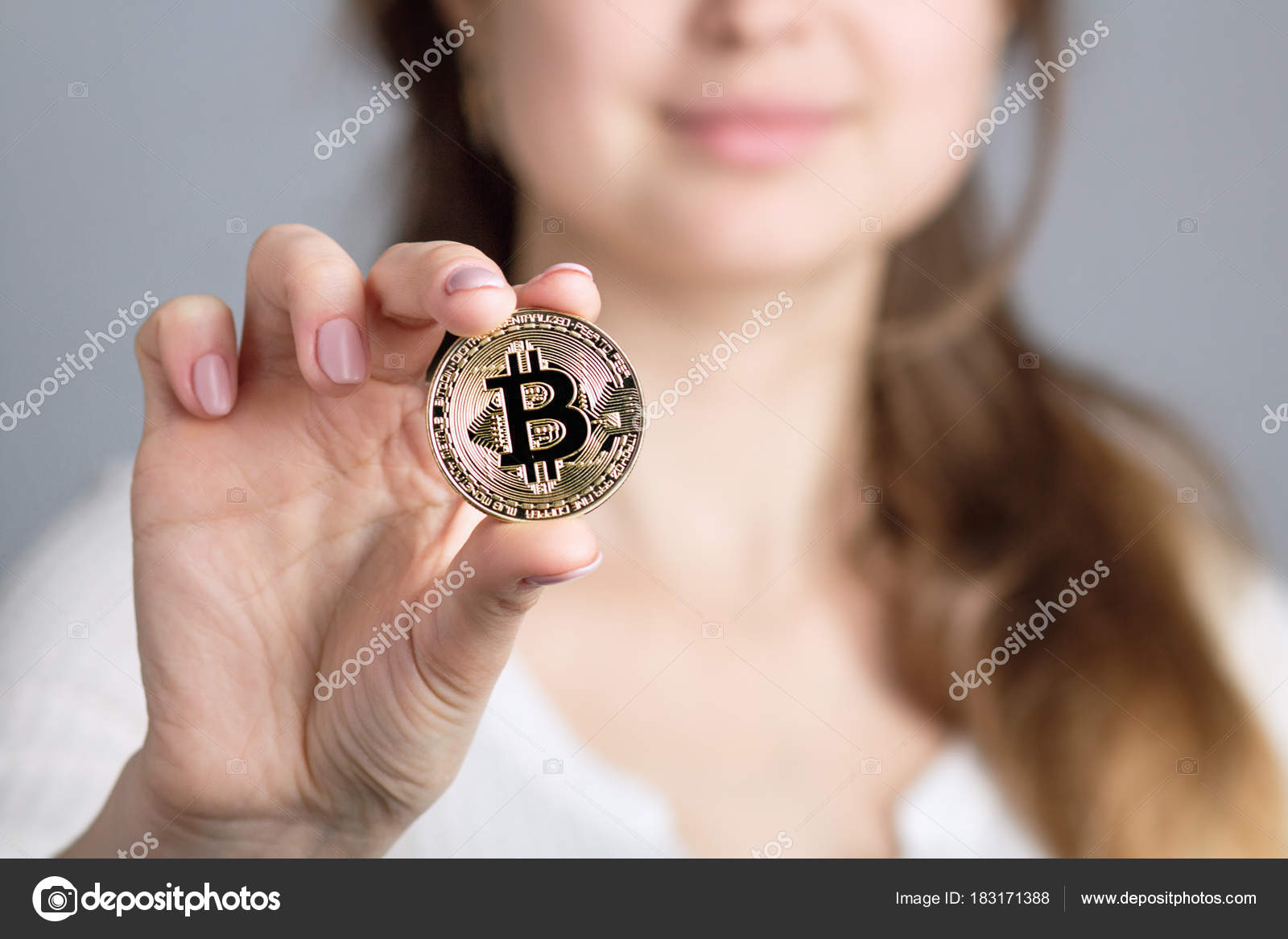Face of a smiling woman holding golden bitcoin in a hand symbol face of a smiling woman holding golden bitcoin in a hand symbol of a crypto biocorpaavc