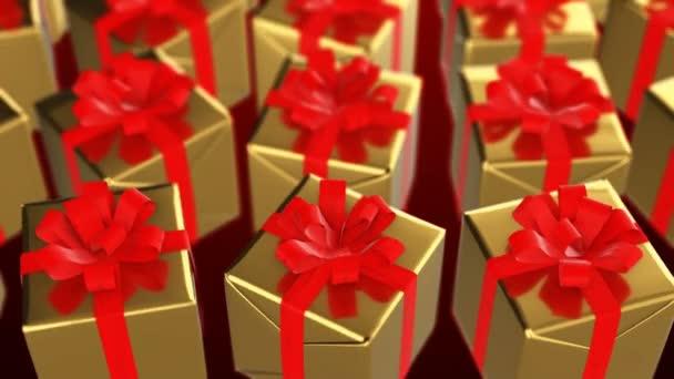 Nový rok a Vánoce zlaté dárkové krabice s červenou stužkou smyčka