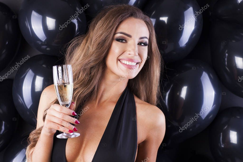 Sexy woman in black dress with balloons.