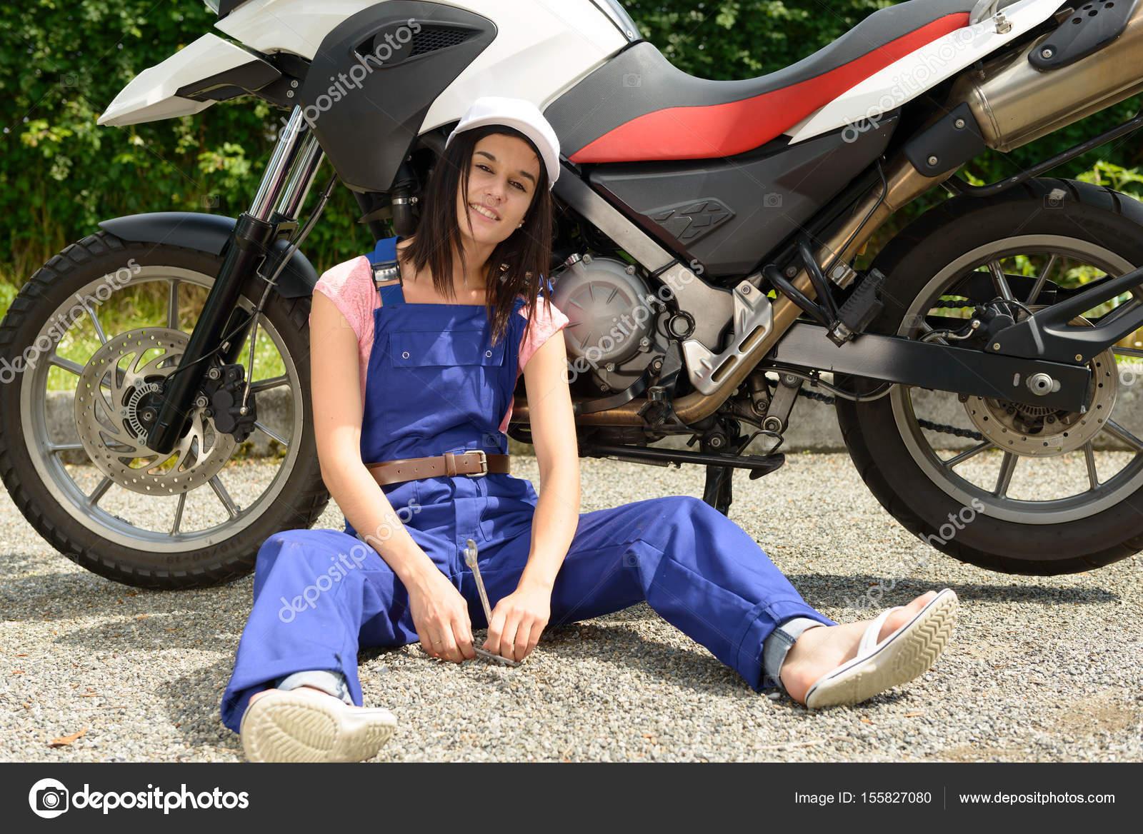 a student girl in motorbike mechanics photo by philipimage