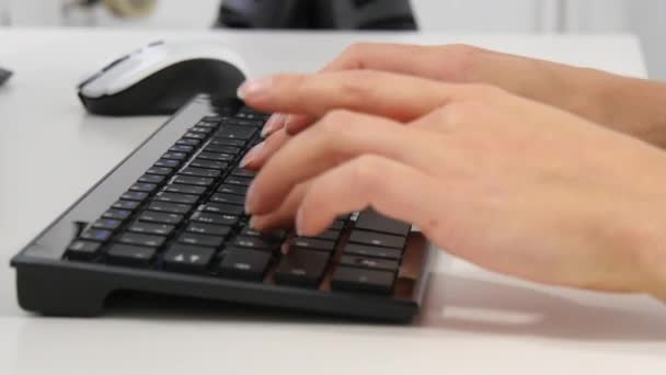 Close-up of hands typing on computer keyboard