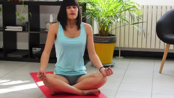 sporty woman in blue sportswear practicing yoga lotus pose