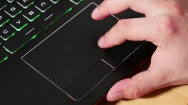 Close up of  hand touching a touchpad on laptop