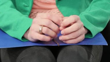 nervous young woman before the interview, close up of hands