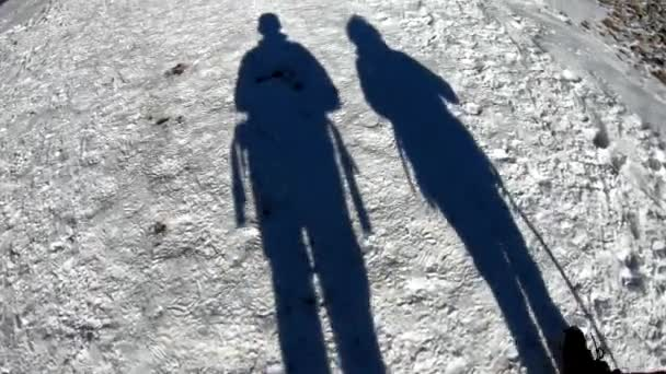 Two shadows on the snow