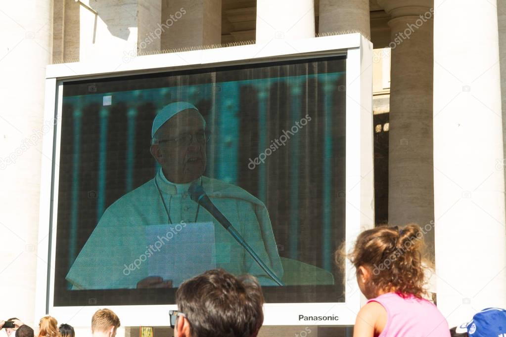 Pope Francis giving Papal Audience on large screen