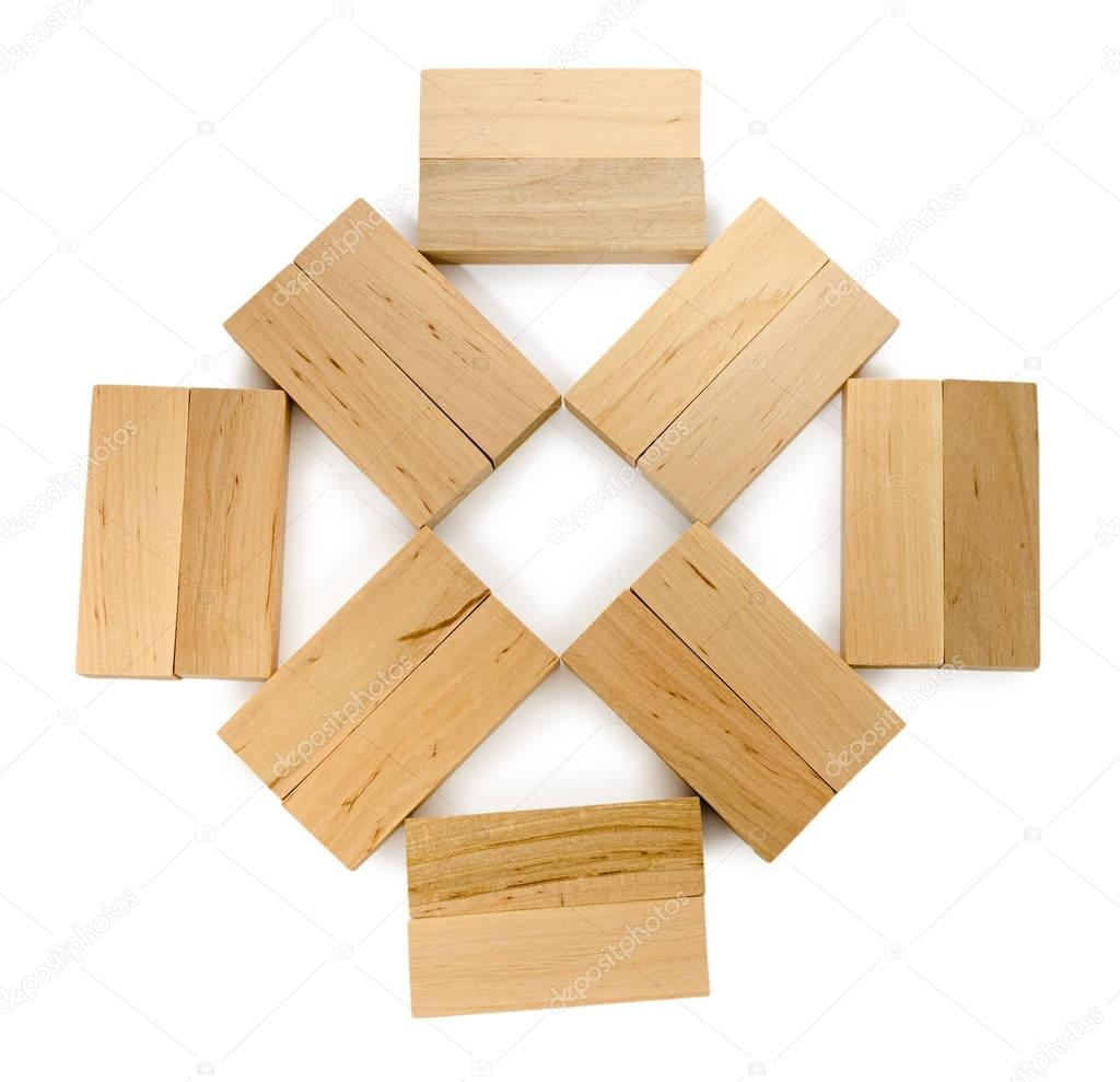 Structure of wooden bricks, looks like flower or sun — Stock Photo