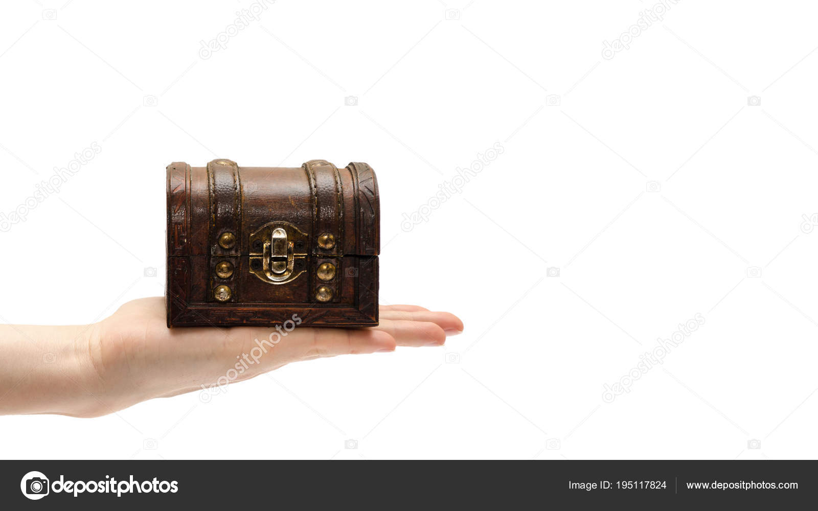 female hand holding treasure chest isolated on white background