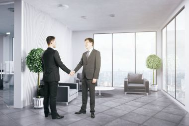 Side view of two handsome businessmen shaking hands in contemporary office interior with city view. Coworking concept. 3D Rendering
