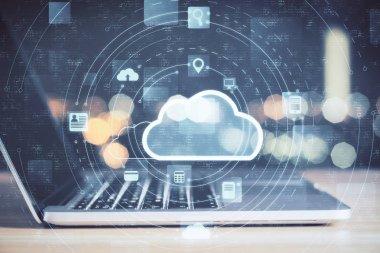 Laptop with cloud computing diagram