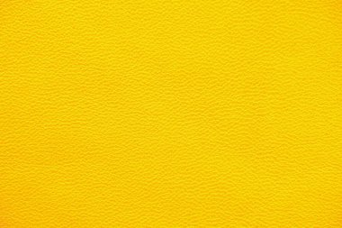 Texture of genuine leather yellow color closeup.