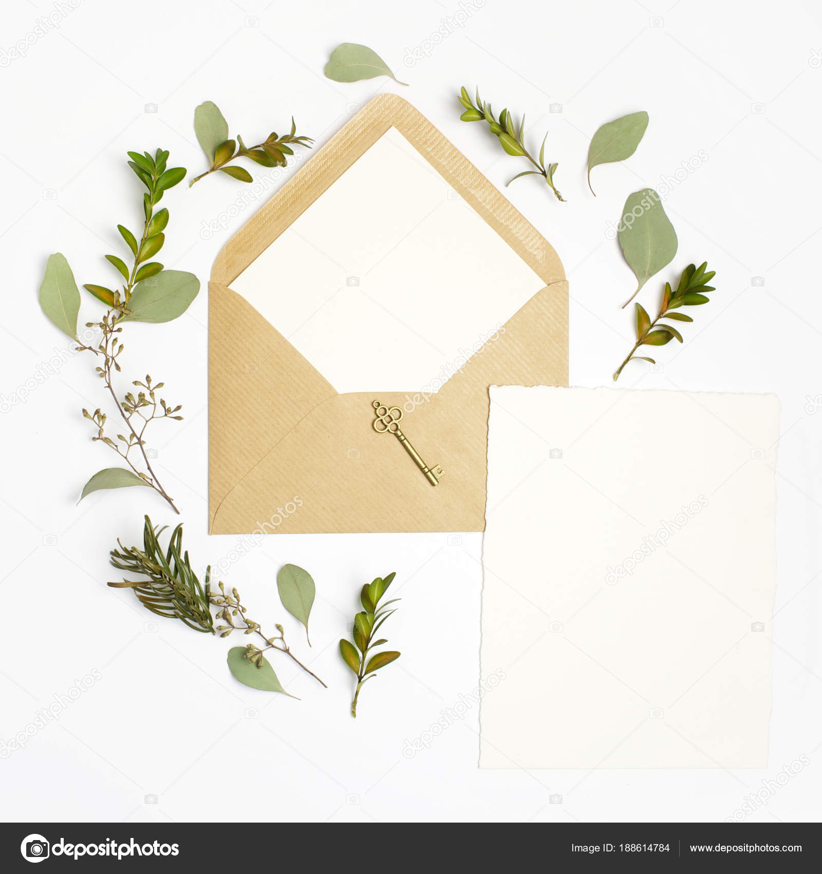 flat lay shot of letter and eco paper envelope on white background wedding invitation cards