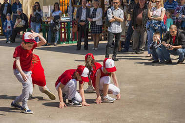 Dance group of children performs hip hop