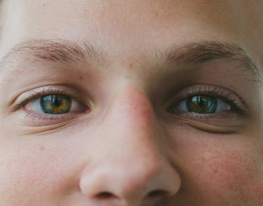 green eyes of young man