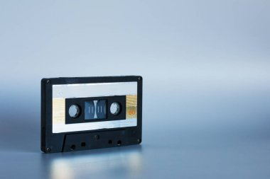 Old audio cassettes on a white background. Copy paste space.