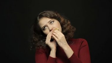 Beautiful woman eating hamburger, closeup shooting