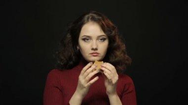 Brunette woman eating fast food, closeup shooting