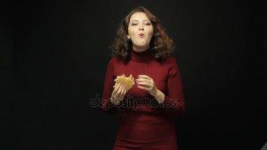 Brunette woman eating hamburger
