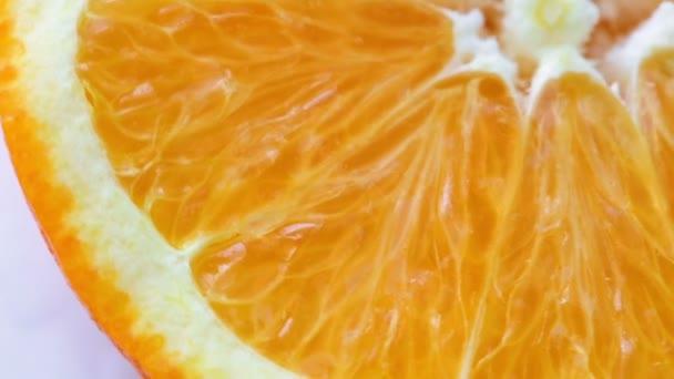 Rotating slice of fresh orange