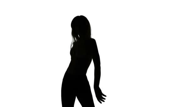 Ragazza esile sessuale di dancing isolata, silhouette