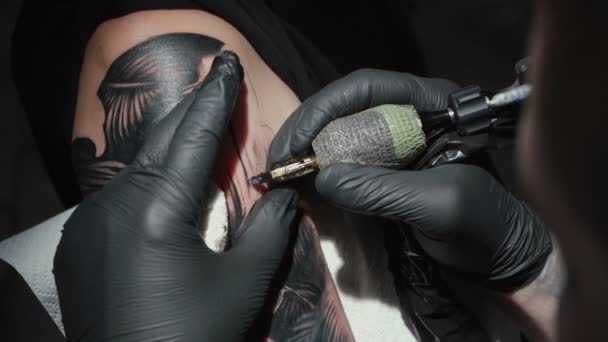 Video of man doing tattoo of snake for woman