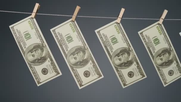 Video of fluttering currency on clothesline rope