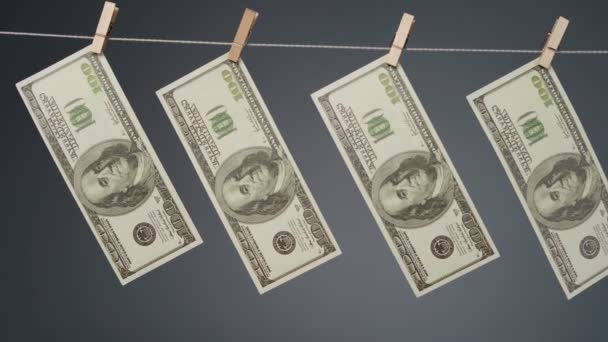 Footage of money drying on clothesline rope