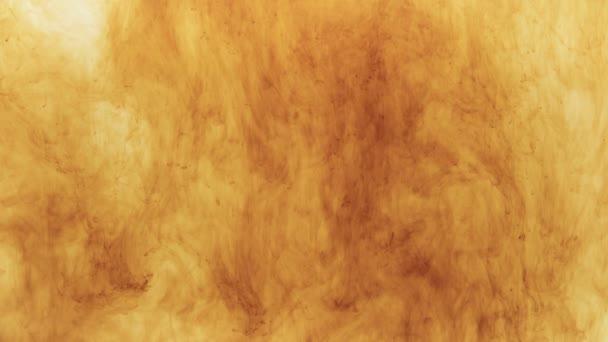 Fotografování hnědé barvy rozpuštěné v kapalině