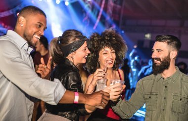 Multiracial young friends dancing at night club - Happy people having crazy fun at nightclub after party - Nightlife drunk concept with afterparty guys and girls celebrating at concert festival event