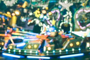 Blurred defocused bokeh lights at Christmas luna park carousel roundabout - Winter market festive concept having fun around the world - Fun games and funfair fantasy background - Vintage filter