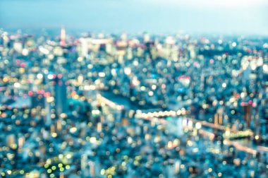 Aerial bokeh of Tokyo skyline from above after sunset on blue hour - Japanese world famous capital with spectacular nightscape panorama - Vintage azure filter on blurred defocused night lights