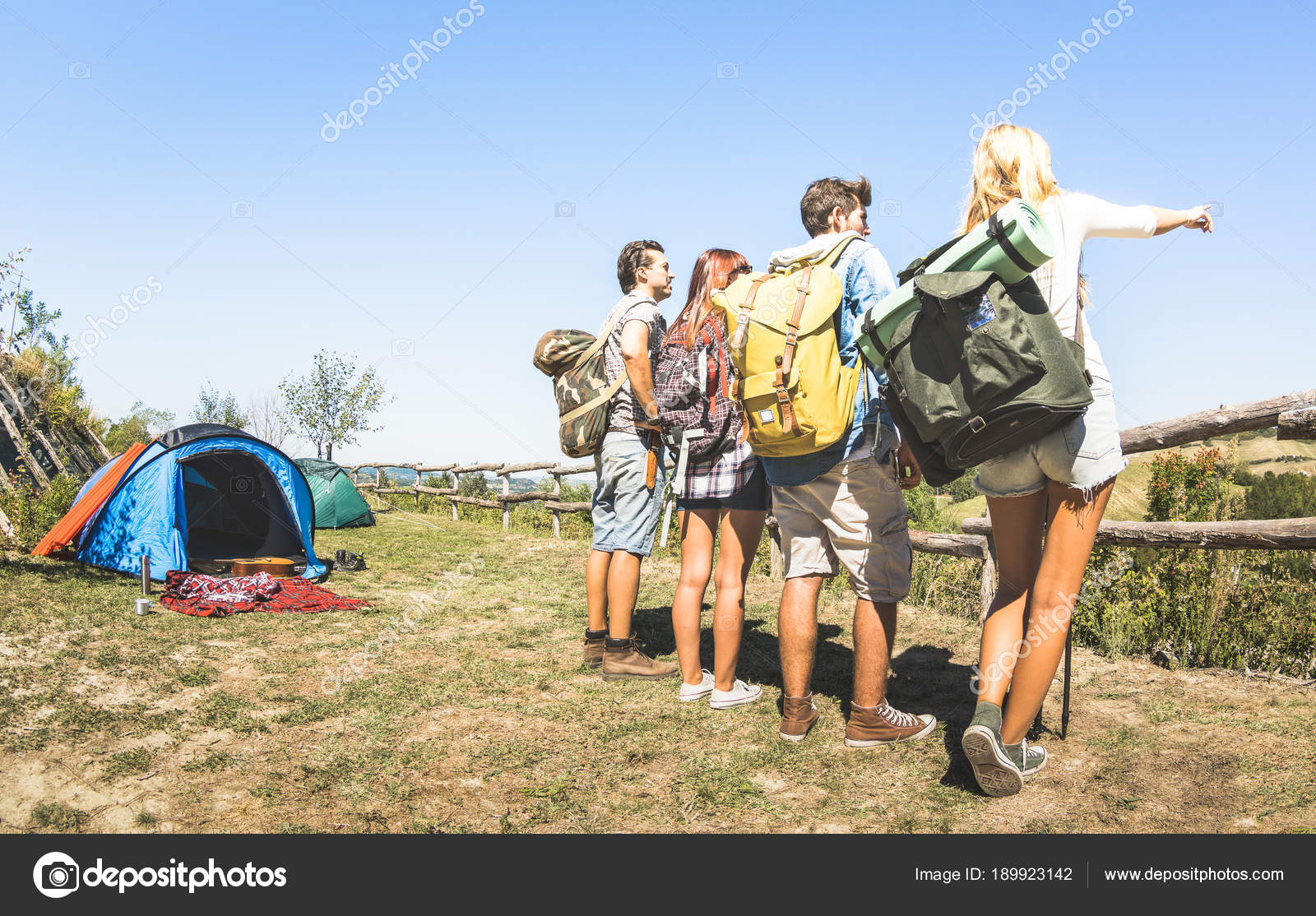 ... trip camp on italian hills on sunny day - Hikers with backpacks and  sticks walking on contry - Wanderlust travel concept with young people at  excursion ...