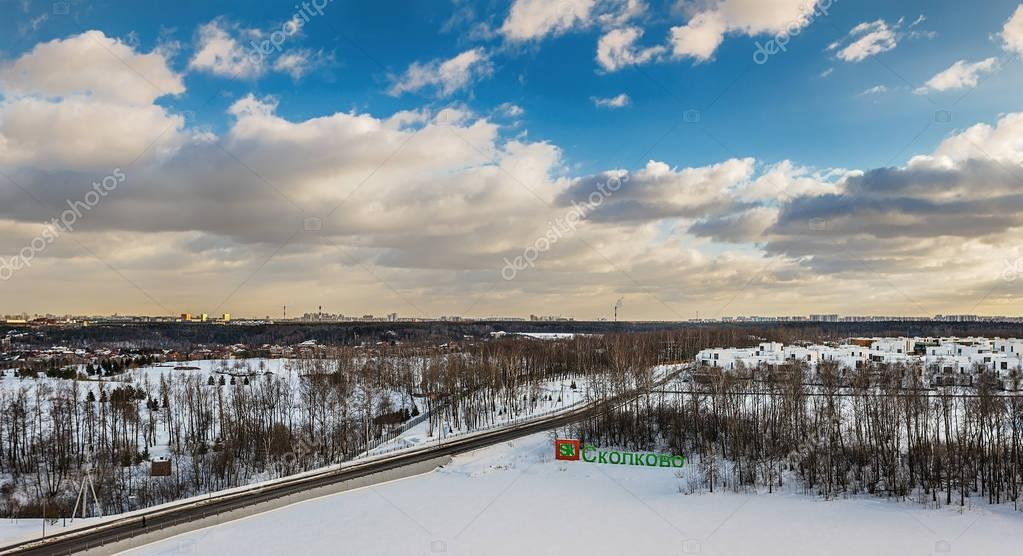 Moscow. February 15, 2017. Horizontal panorama of a winter landscape with the road and a logo of innovation center Skolkovo.