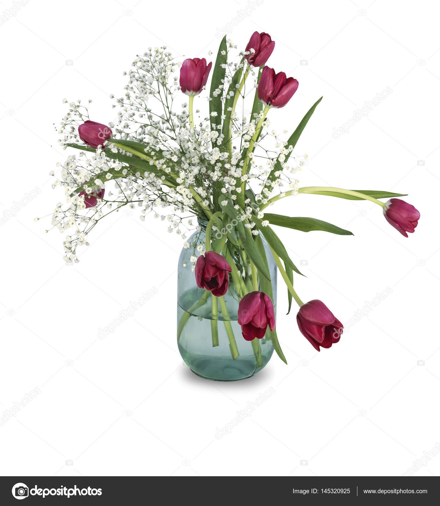 A bouquet of spring flowers from tulips with gypsophila in a three ...
