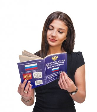 A young woman holds in her hands and reads the book