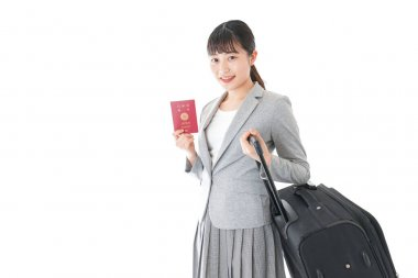 asian young woman with suitcase and passport isolated on white background, travel concept