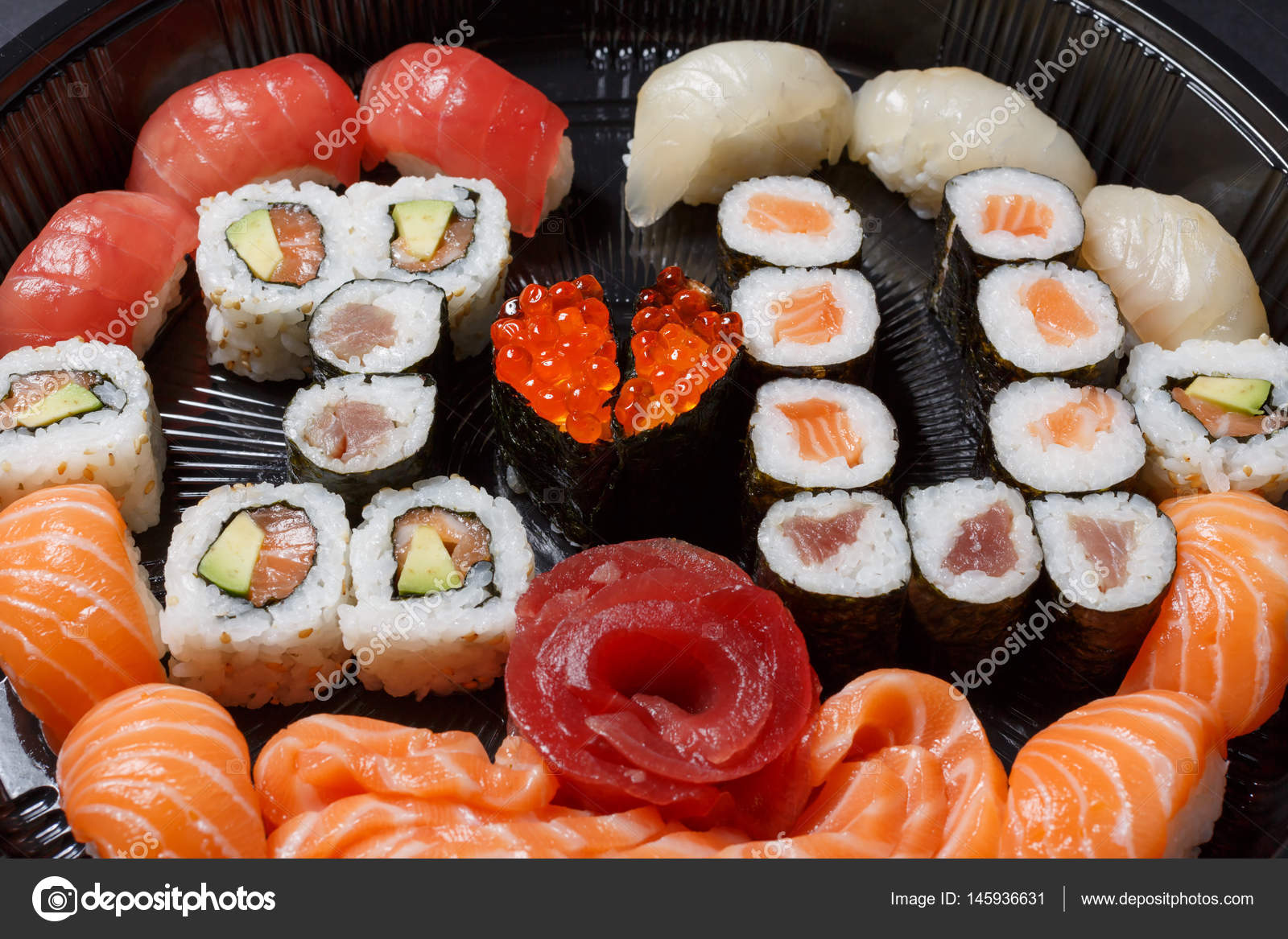 9834a649f A large set of sushi and rolls view from above. A lot of food in one plate.  Dishes from raw fish Japanese food.A dish in a romantic style. I love you.
