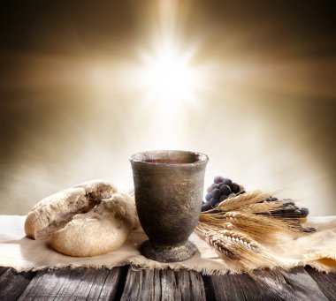 Communion - Unleavened Bread With Chalice Of Wine And Cross Light