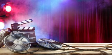 -Film movie Background - Clapperboard And Film Reels In Theater