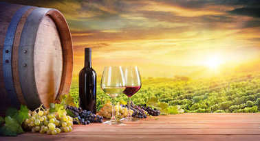 Wine Glasses And Bottle With Barrel In Vineyard At Sunset stock vector