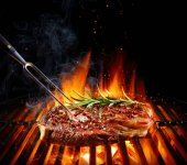 Fotografie Entrecote Beef Steak On Grill With Rosemary Pepper And Salt