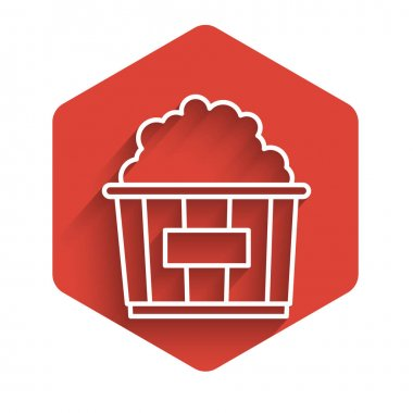 White line Popcorn in cardboard box icon isolated with long shadow. Popcorn bucket box. Red hexagon button. Vector Illustration
