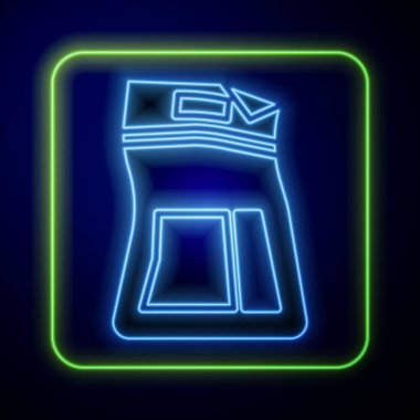 Glowing neon Cement bag icon isolated on blue background.  Vector Illustration icon