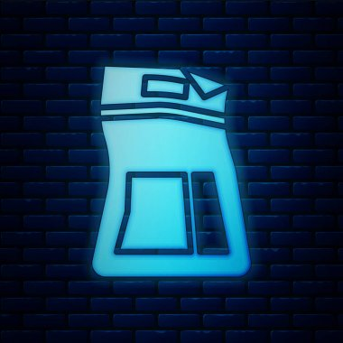 Glowing neon Cement bag icon isolated on brick wall background.  Vector Illustration icon